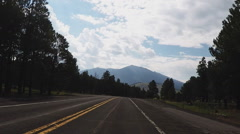 Driving Highway 180 East Into Kendrick Park With Humphreys Peak- Flagstaff AZ Stock Footage