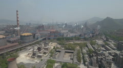 Aerial drone view of old state owned steel mill in Northern China Stock Footage