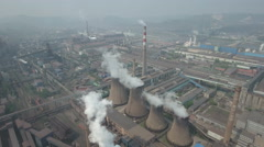 Tilting aerial drone shot of coal fired power plants and steel factory in China Stock Footage