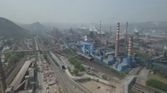 Panoramic aerial shot of massive state owned enterprise producing steel in China Stock Footage