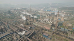 Drone flight over massive steel factory and coal fired power plant in China Stock Footage