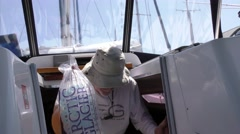 Old man loading ice in a sailboat cabin Stock Footage