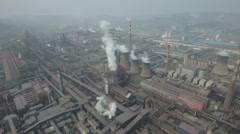 Chimneys billow smoke, steel factory, aerial drone footage, heavy industry China Stock Footage
