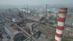 China heavy industry, air pollution, smokestacks of steel manufacturing company Stock Footage