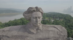 Rotating aerial shot of massive sculpture Mao Zedong head in China Stock Footage