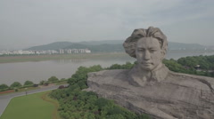 Aerial shot flying towards huge Mao Zedong statue in Changsha, China Stock Footage