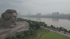 Flying past Mao Zedong statue revealing skyline Changsha city in China Stock Footage