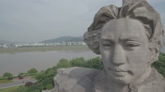 Closeup slow drone view of a Mao Zedong statue in Changsha China Stock Footage