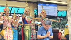 Thai dancers dancing and paying respect to the Erawan Shrine in Bangkok. Stock Footage