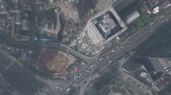 Overhead drone shot of two skyscrapers under construction in urban China Stock Footage
