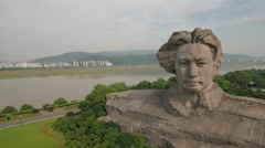 Aerial drone shot of sculpture Mao Zedong, landmark monument Changsha China Arkistovideo