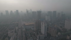 Flying towards downtown Chengdu in central China, smog and air pollution Stock Footage