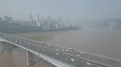 Aerial drone flight bridge over Yangtze river and Chongqing skyline China Stock Footage