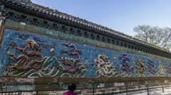 Walking and seeing the Nine Dragons Screen in Beihai Park, Beijing, China Stock Footage
