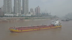Flying along a chemical tanker vessel on the Yangtze river in Chongqing China Stock Footage