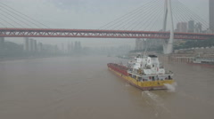 Aerial drone shot of chemical tanker vessel on Yangtze river in Chongqing Stock Footage
