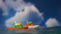 A PAIR OF TOY BOATS BATTLE BIG WAVES Stock Footage