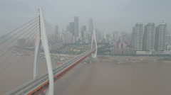 Aerial drone view cable-stayed bridge Yangtze river, Chongqing skyline China Stock Footage