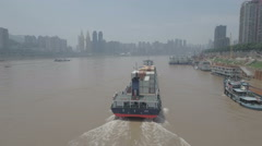 Aerial tracking shot of a cargo vessel sailing over Yangtze river Chongqing Stock Footage