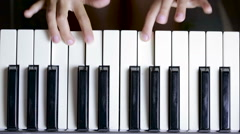 The hand on piano key in close-up shot. child learning to play the piano Stock Footage
