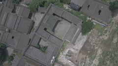 Overhead view of traditional style homes and construction pit in Chongqing Stock Footage