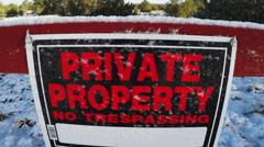 Private Property No Trespassing Sign On Fence With Snow Stock Footage