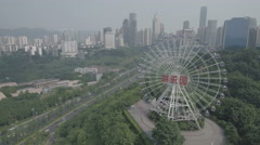 Aerial drone shot of ferris wheel and amusement park in Chongqing China Stock Footage