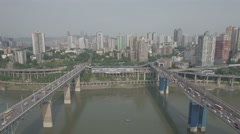 Abstract aerial sliding shot of two bridges spanning a river in Chongqing Stock Footage