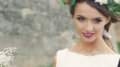 Smart bride smiling to the groom in wind day outdoor. Slowly Stock Footage