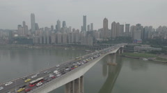 Panoramic overview of traffic driving over bridge, Chongqing skyline urban China Stock Footage