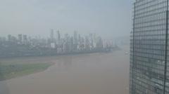 Flying past tall modern skyscraper office buildings revealing Chongqing skyline Stock Footage