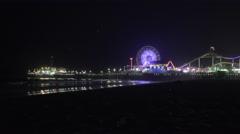 Santa Monica pier at night lights ferris wheel beach ocean Stock Footage
