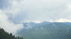 TIME LAPSE: Green mountain forest in clouds before the rain. Mountain chain in Stock Footage