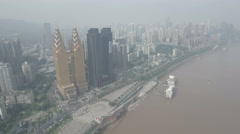 Golden towers Sheraton hotel Chongqing, aerial drone shot China Stock Footage