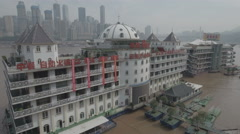Drone shot of floating restaurant hotel on Yangtze river in Chongqing China Stock Footage