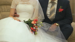 The bride and groom sitting on the sofa Stock Footage