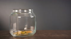 4K Time lapse selective focus of jar with gold coins Stock Footage