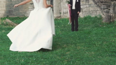 Smart bride running to the groom standing with bouquet. Slowly Stock Footage