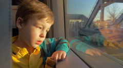In Saint-Petersburg, Russia in train rides a little boy who looks out the window Stock Footage