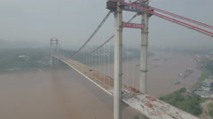 Reverse aerial shot bridge construction, engineering infrastructure China Stock Footage