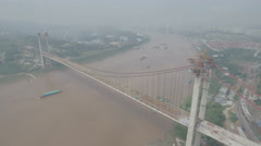Construction of new bridge over Yangtze river in Chongqing, China aerial Stock Footage