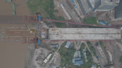 Overhead aerial shot of bridge under construction, infrastructure China Stock Footage