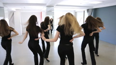 Girls in black uniform actively dance in class on lesson of choreography Stock Footage