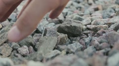 Man chooses and carries stones Stock Footage