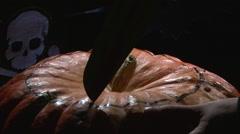 Making the first cut in Halloween pumpkin jack-o-lantern Stock Footage