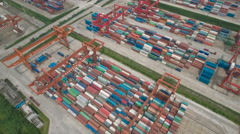 Aerial drone shot flying over colorful containers in river harbor China Stock Footage