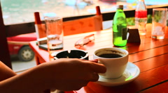 Young woman drinking coffee in the cafe bar Arkistovideo