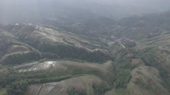 Aerial drone shot of dramatic Longji rice terraces in Southern China Stock Footage