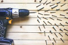 Cordless drill with screws Stock Photos