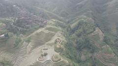 Aerial view of beautiful green rice terraces and small mountain village China Stock Footage